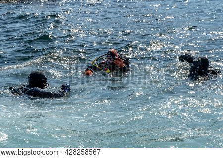 April 17, 2021 - Hamburgsund, Sweden: A Group Of Scuba Divers On The Surface Getting Ready To Descen