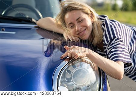 Middle Woman Driver Dreaming, Embracing Hood Of Car After Detailing, Polishing. Smiling Female Custo