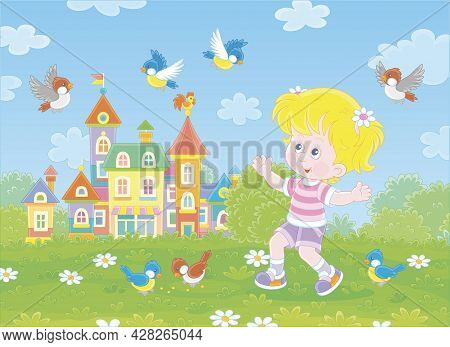 Happy Little Girl Playing With A Flock Of Merry Sparrows And Titmice In A Green Summer Park Of A Pre