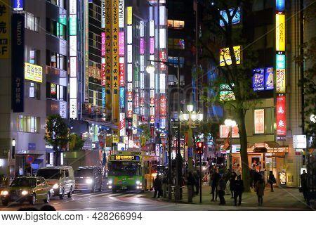 Tokyo, Japan - November 29, 2016: People Visit Tokyo City Ikebukuro District At Night. Ikebukuro Is