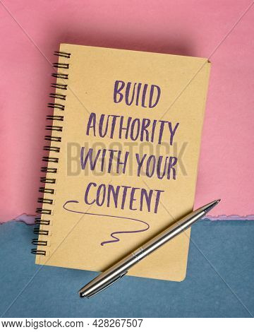 Build authority with your content, blogging, publishing and communication tip - handwriting in a spiral notebook