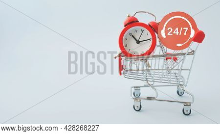 Red Round Paper Cut With Contact 24 Hours 7 Days And Alarm Analog Clock On   Shopping Cart On Blue B