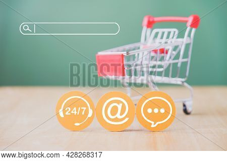 Contact Icon On Yellow Round Paper Cut With Search Bar And Blurred Shopping Cart With On Green Backg