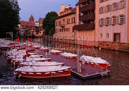 Strasbourg, France, June 23, 2021 : Quai Du Woerthel At Night With The Boat Rental Services On Ill R