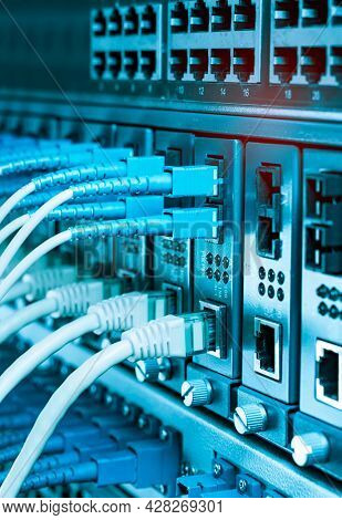Fiber Optic cables connected to optic ports and UTP, Network cables connected to ethernet ports