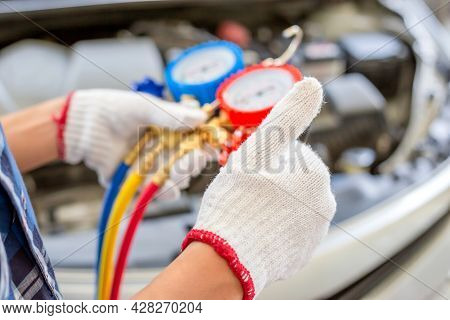 Air Conditioning Repair, Repairman Giving Thumbs Up And Holding Monitor Tool To Check And Fixed Car