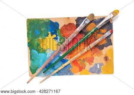 Paint brush and palette for art painting isolated on white background. Paintbrush for oil painting as artistic paint still life. Abstract art concept