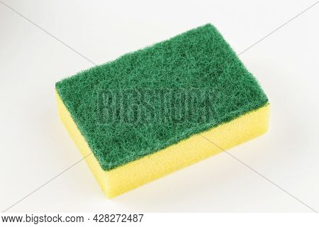 A New Sponge On A White Background. Cleanliness Concept. Indoor Cleaning.