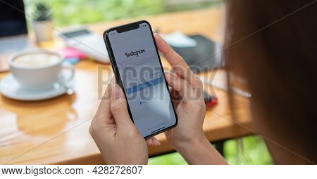 Chiang Mai, Thailand - June 6, 2021 : Woman Hand Holding Iphone X With Instagram Application On The