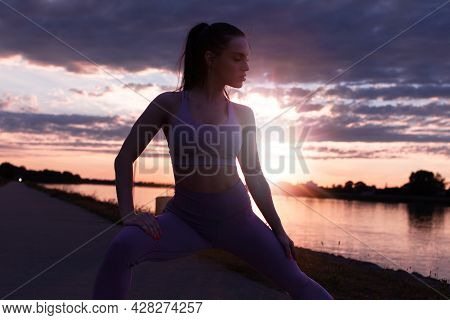 Young Woman In Sportswear Stretching Before Running At Sunrise, Warm Up Exercise