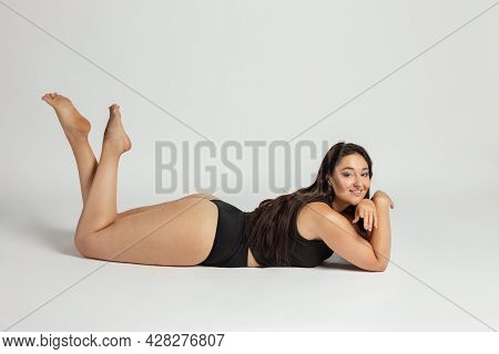 Young Beautiful Plump Woman In Cotton Underwear On White Background
