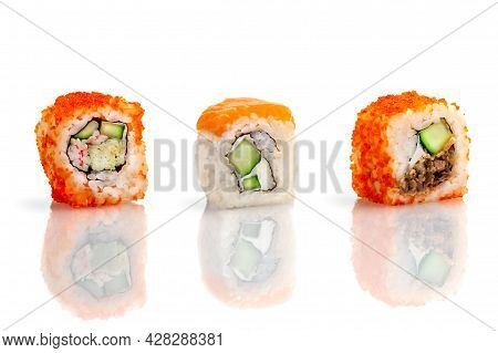 set of sushi rolls on a white background with reflection. Sushi roll with rice, tofu cheese, red flying fish caviar, crab meat and avocado. Sushi menu. Japanese cuisine, restaurant. Seafood, Asian cuisine