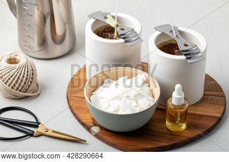 Ingredients And Tools For Handmade Aroma Candles. Organic Soy Wax, Essential Oils, Wicks, Pots