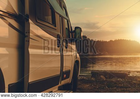 Class B Rv Recreational Vehicle. Motorhome Camper Van Camping Next To The Bay At Sunset. Scenic Nord
