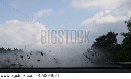 Misting Windshield While Wipers Off. Car Window In Rain Pour. Misted Glass Of Windscreen With Raindr