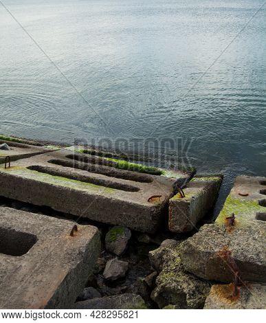 Coastal Defense At The Sea Coast. Sea Wall (seawall). Breakwater. Concrete Blocks And Stones. The Bl