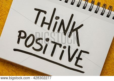 Think positive inspirational handwriting in a sketchbook, positivity, optimism and mindset concept