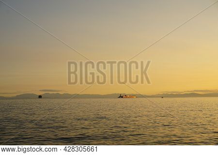 Incredible Beautiful Colorful Sunset Over The Pacific Ocean. Barges On Background.