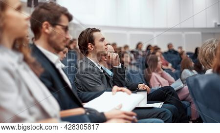 Young Business People Listening To A Lecture In The Conference Hall.