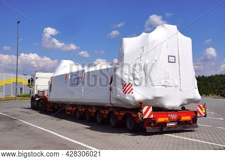 Oversize Load Or Exceptional Convoy. A Truck With A Special Semi-trailer For Transporting Oversized