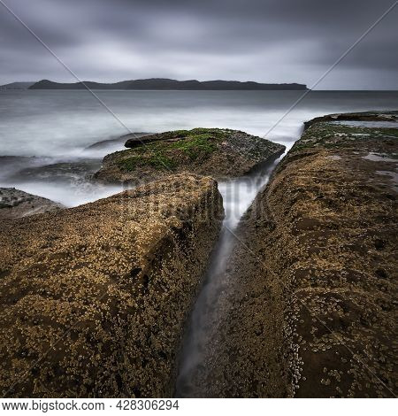 Water Between The Rocks At Pearl Beach On Nsw Central Coast