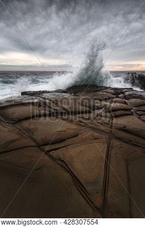 Water Splashing Up Onto The Rocks At Winney Bay On Nsw Central Coast