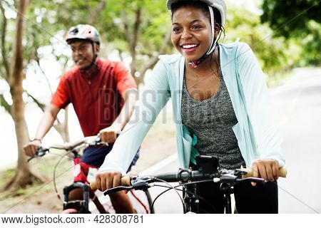 Cyclist couple riding together in a park
