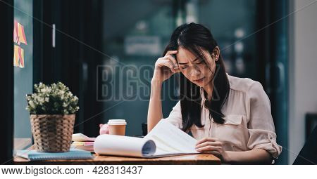 Tired Young Asian Woman Feel Headache From Working Problem. Stressed Female Suffer From Headache Bad