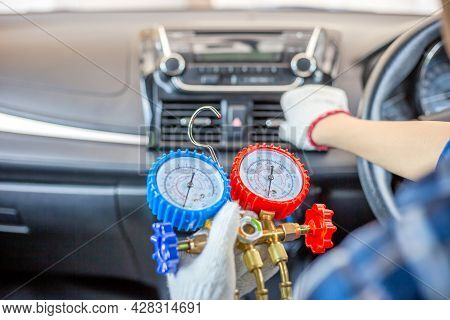 Repairman Holding Monitor Tool To Check And Fixed Car Air Conditioner System, Technician Check Car A
