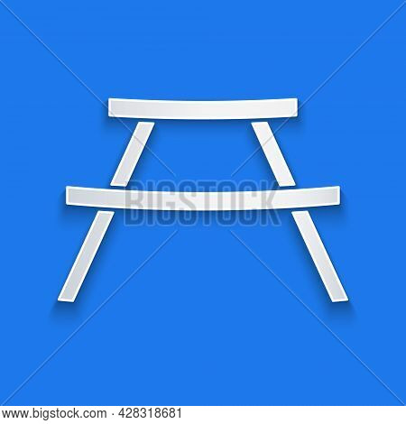 Paper Cut Picnic Table With Benches On Either Side Of The Table Icon Isolated On Blue Background. Pa