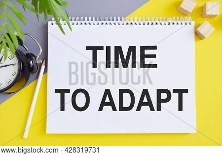 Time To Adapt Word Concept Written In Notebook