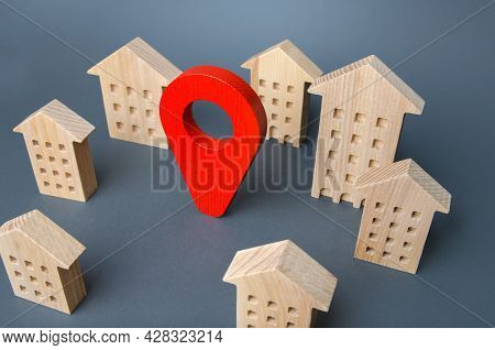 Wooden Houses And A Red Location Pin. Location, Accessibility To Infrastructure. Residential Complex