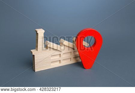 Industrial Plant And Red Location Pin. Concept Of The Location Of Production Facilities. Logistics,