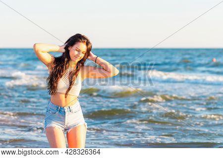 Young Woman Playing In The Sea In Summer. Woman Enjoying In Sea Water.cheerful Young Woman Having Fu