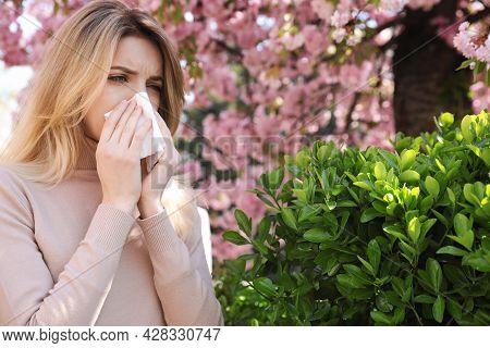 Woman Suffering From Seasonal Pollen Allergy Outdoors