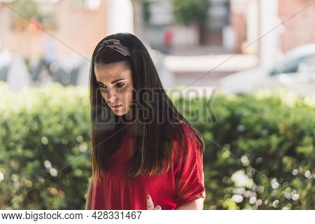Young Woman Looking At A Shop Window