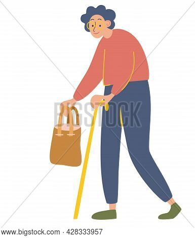 An Elderly Woman. Grandmother With A Bag And A Cane In Her Hands. Old Age Pensioner Leans On A Cane.