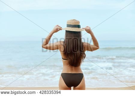 Portrait Beautiful Young Woman In Bikini  Looking At Ocean. Rear View Of Girl. Freedom Concept, Holi