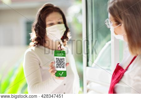 Digital Covid-19 Vaccination Certificate On Mobile Phone. Coronavirus Vaccinated People Scan Qr Code