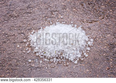 A Pile Of Large Hail On The Ground