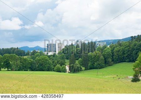 Skyscrapers Of La-chaux-de-fonds, Switzerland, In The Midst Of The Nature