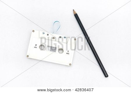 A Pencil And An Audio Cassette Tape
