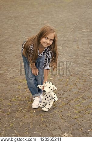 Play Is Simple Joy. Happy Baby Play With Toy Dog Outdoors. Child Development. Games And Activities.