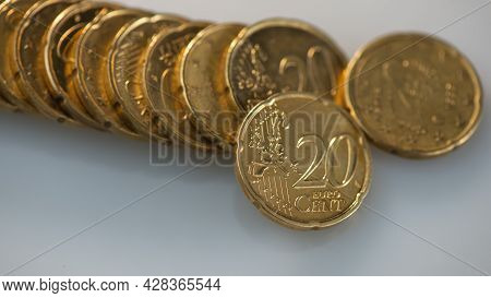 Stack Of Twenty Euro Cents Lies On A Gray Background. Web Banner.