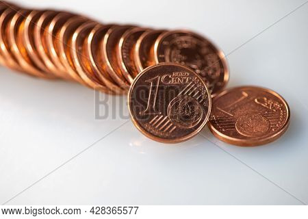 Stack Of One Euro Cent Coins Lies On A Gray Background. Web Banner.