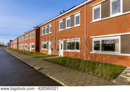 Brand New Development Of Basic Public Housing In A Village In The Netherlands. Neighborhood Scene Of