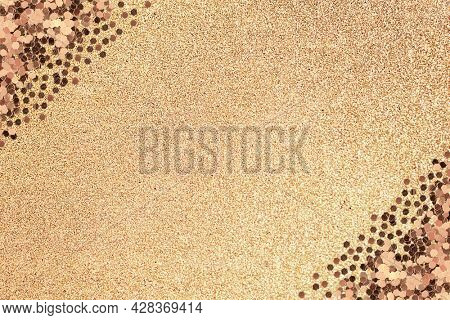 Shimmering glitter confetti frame on a gold background