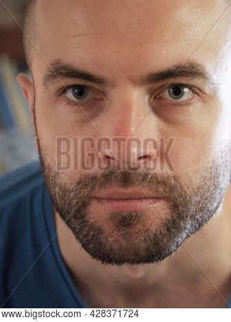 The Gaze Of A White Man. Portrait, Close-up. A Man With A Stubble On His Face.