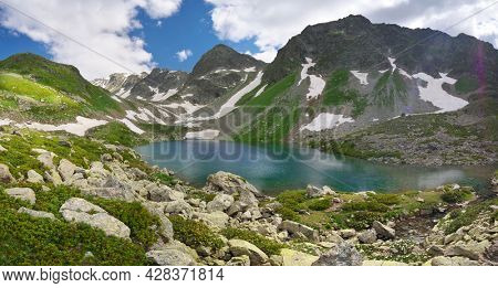 Landscape of Caucasus Dukka lake in mountain. Composition of nature.