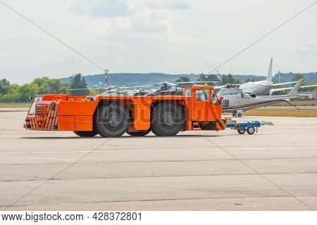 Aerodrome Orange Tow Tractor Is Driving Along The Steering Paths At The Airport